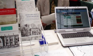 books on a stand, open laptop | photo: Barbara Tearle